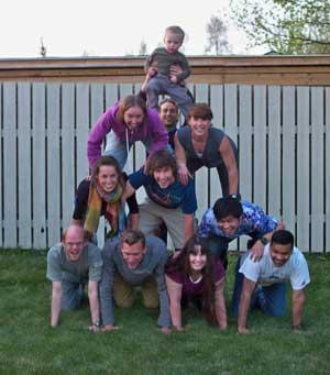 Photo of lab members making a pyramid.